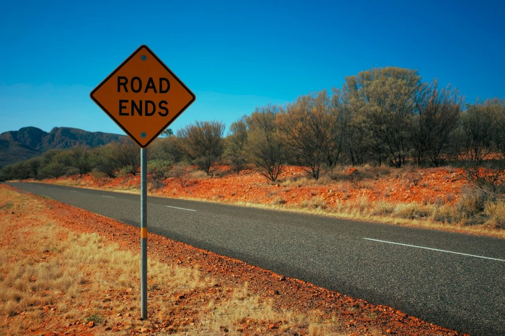 """Road with a sign next to it reading """"Road Ends"""""""